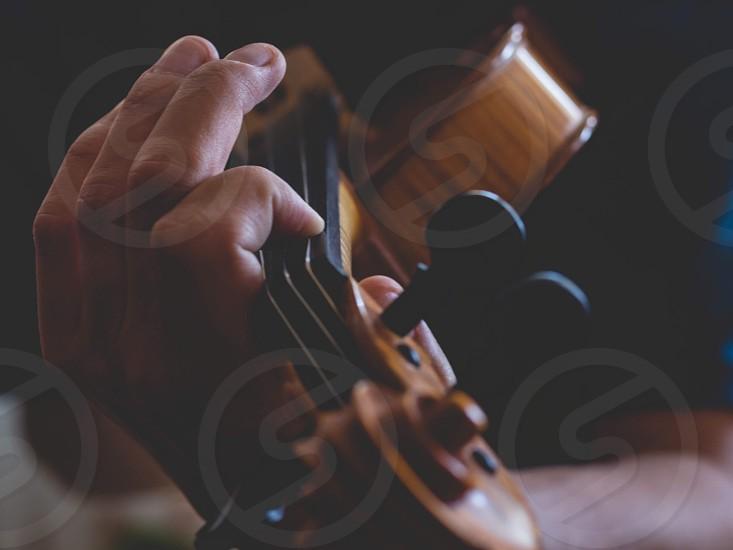 Violin playing music instrument  photo