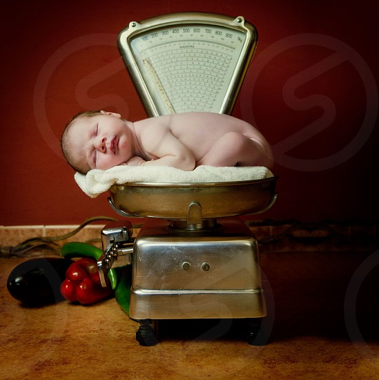 baby on weighing scale photo