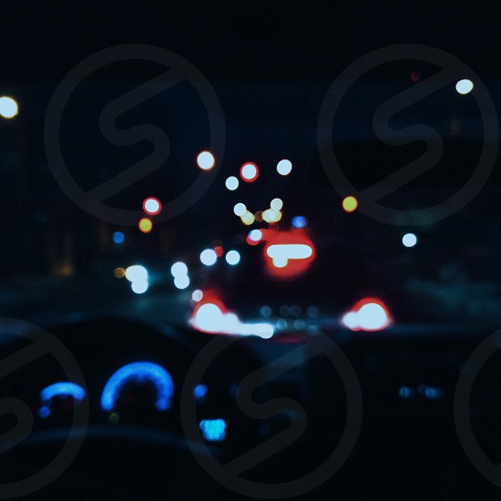 red car tail lights photo