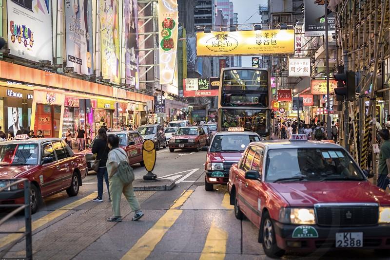 Hongkong mongkok busy street lights advertising people cars crossing bus coty traffic photo