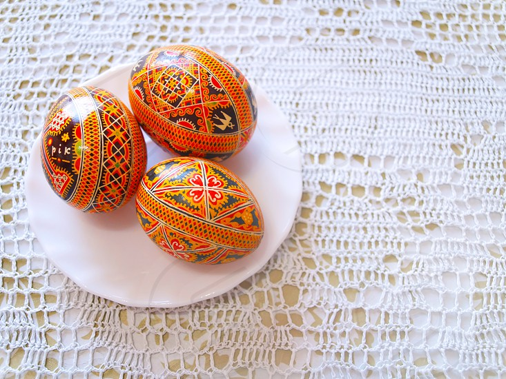Easter eggs painted traditional knitted background handmade photo