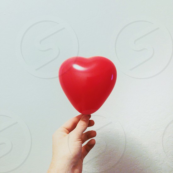 heart shaped red balloon photo