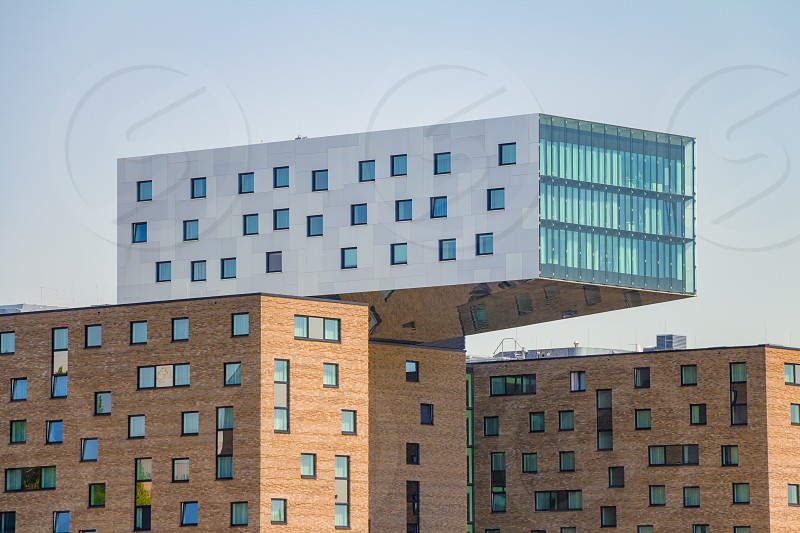 Modern office building along the Spree River in East Berlin. It's look like it floating in the air. photo