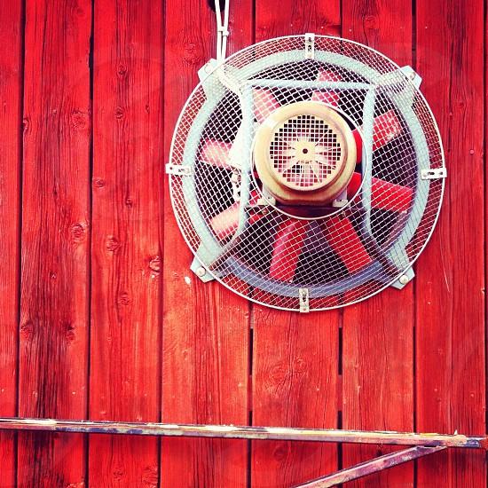 red and white round speaker photo