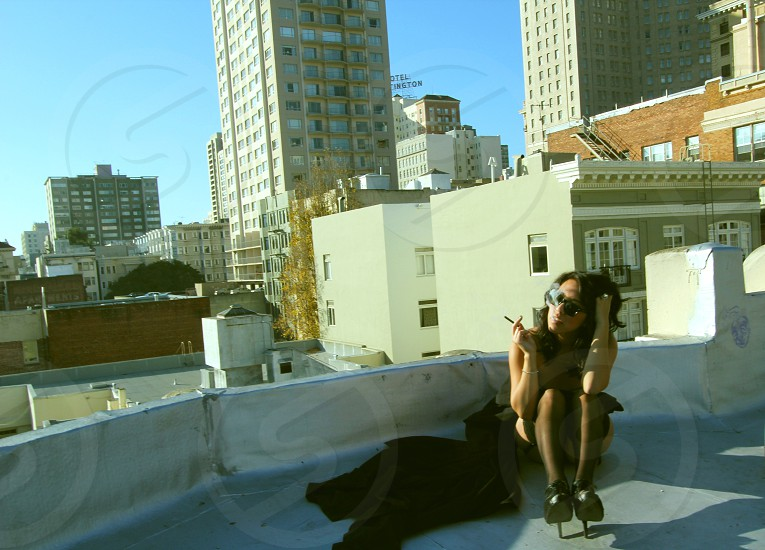 woman sitting on top of roof photo