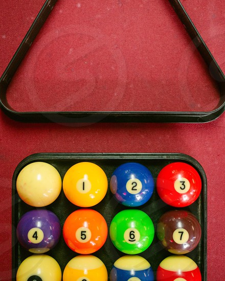 billiard balls on black plate container photo