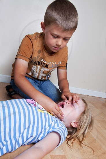 boy and girl performing mouth to mouth resuscitation photo