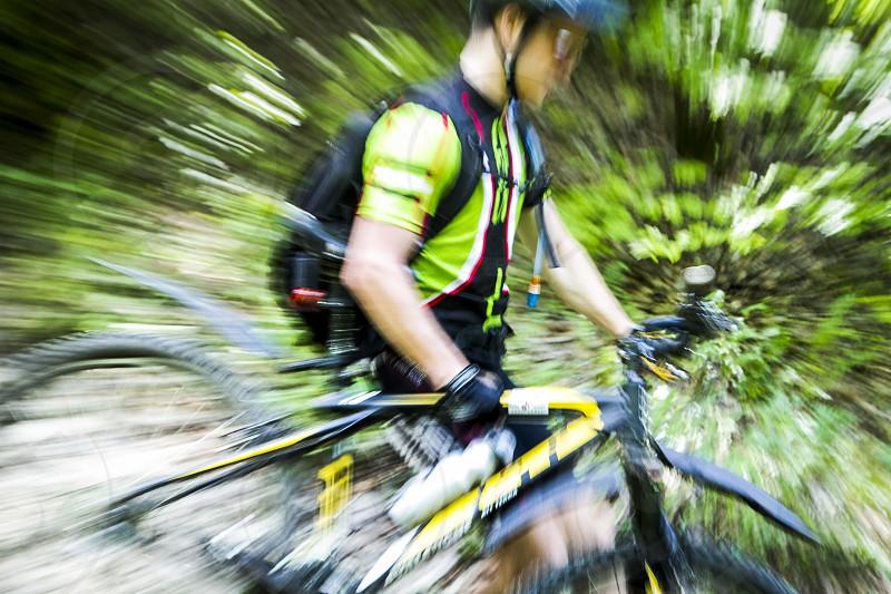 Cross country biker mountain bike zoom effect photo