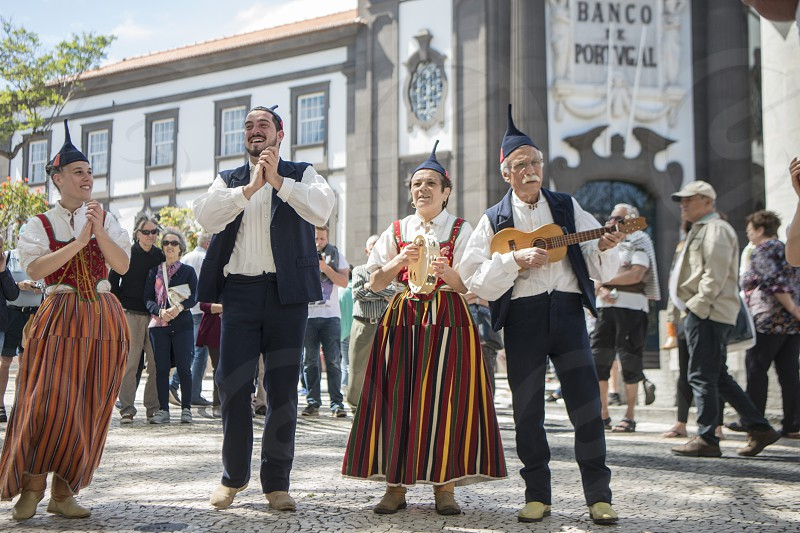 a traditonal madeira folklore music group s at the Festa da Flor or Spring Flower Festival in the city of Funchal on the Island of Madeira in the Atlantic Ocean of Portugal.  Madeira Funchal April 2018 photo