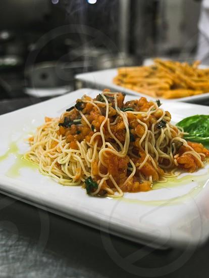 pasta on white ceramic plate photo