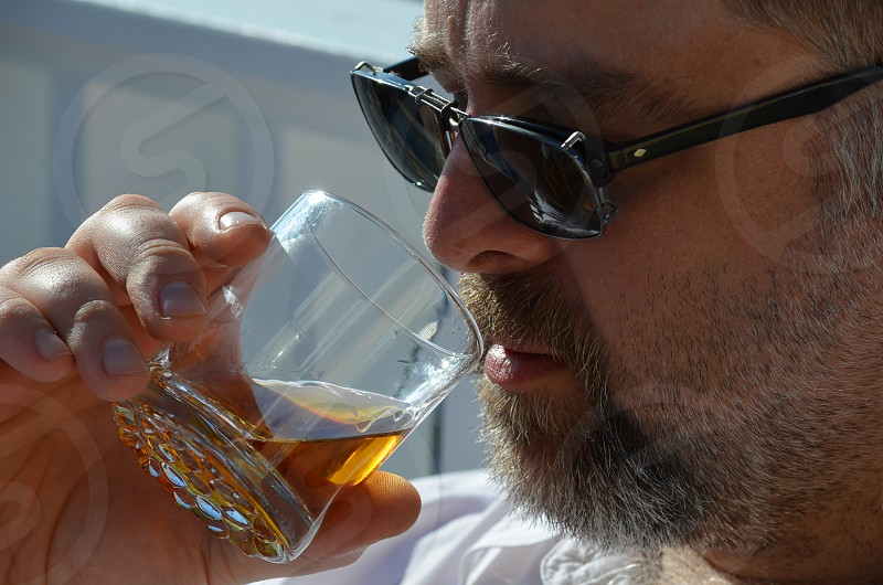 contemplation over a sip of whiskey photo