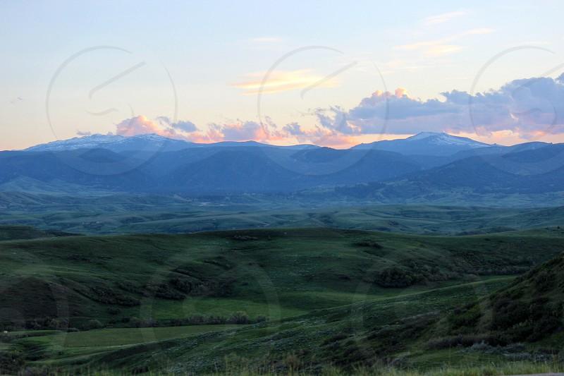 green grassland and gray mountain photo