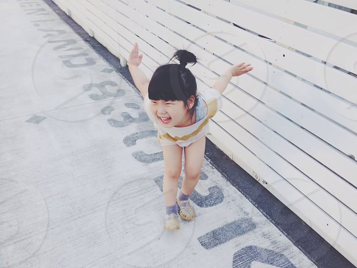 She wants to be a bird. photo