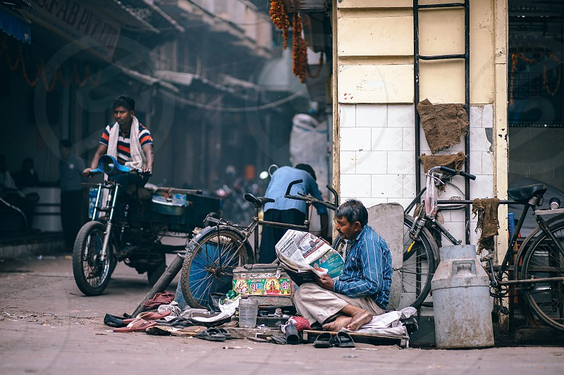 Reading the morning paper. photo
