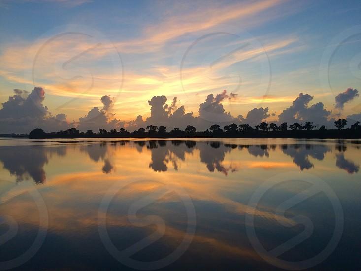 SunriseMexicosimplecloudsriverbeautiful photo