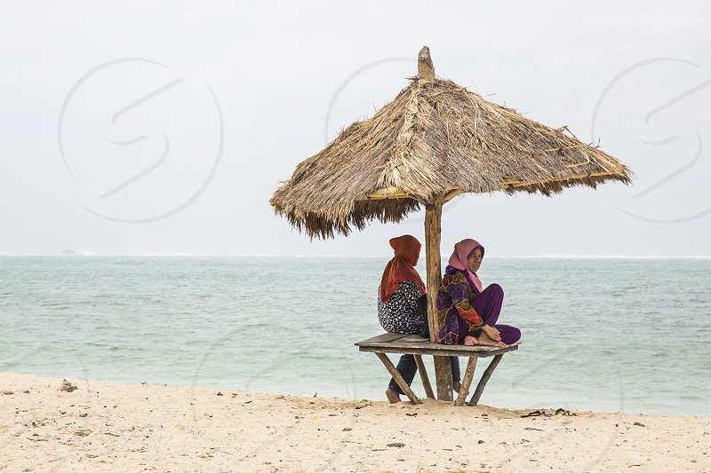 Muslim women spend a day at the beach in Kuta Lombok Indonesia. photo