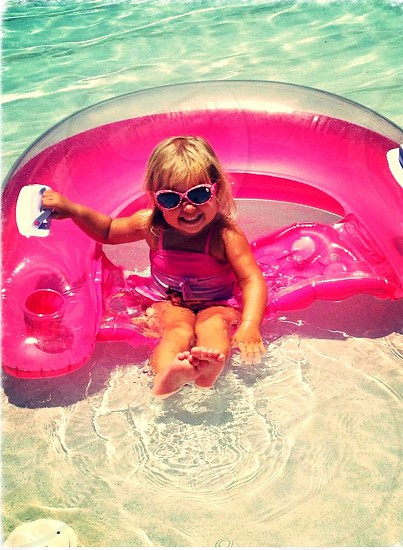 baby girl wearing pink sun glasses photo