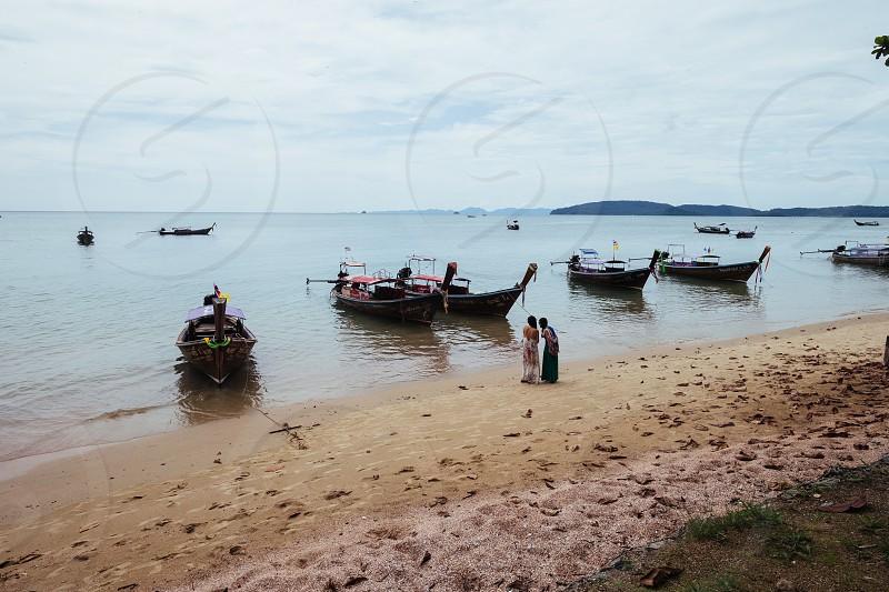 Fisher boats at Ao Nang Beach in Ao Nang Krabi Thailand photo