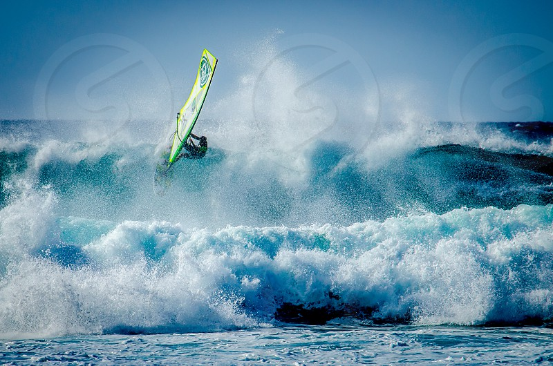 surfer on maui surfing the big waves photo