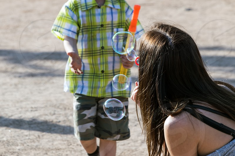 Trying to catch soap bubbles photo
