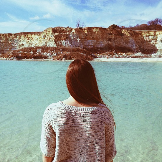 Girl looking out into quarry  photo