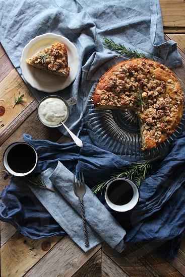 Pear & cornmeal coffee cake with rosemary creme fraiche. photo