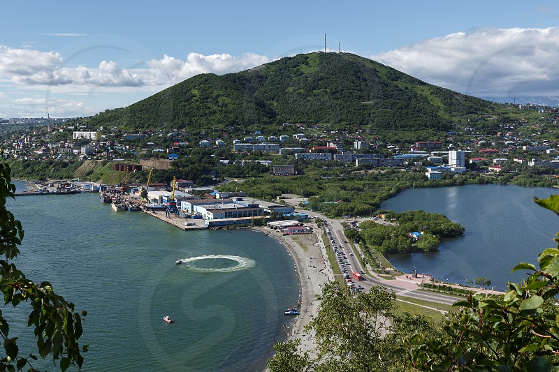 Beautiful summer city landscape: view of seaport Petropavlovsk-Kamchatsky Avacha Bay Kultuchnoe Lake and Mishennaya Mountain on a sunny day. Far East Russia Kamchatka Peninsula. photo