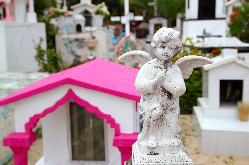 Caribbean children catholic cemetery with angel saints figures in Mexico photo
