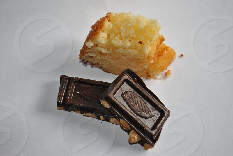 2 dark chocolates with nuts beside brown pastry photo