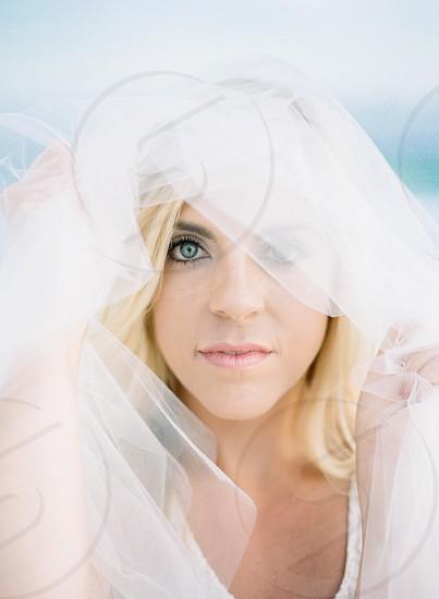 Wedding tulle blue eyes beach wedding bride bridal portrait photo