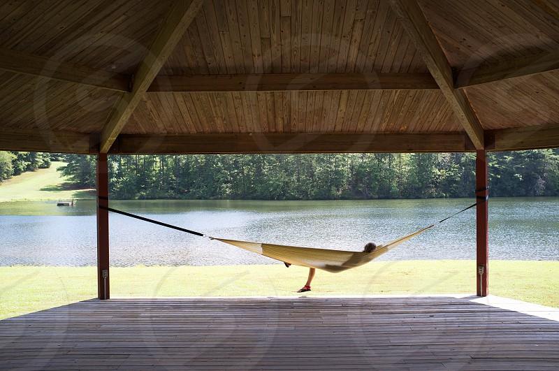 hammock under gazebo next to waterfront photo