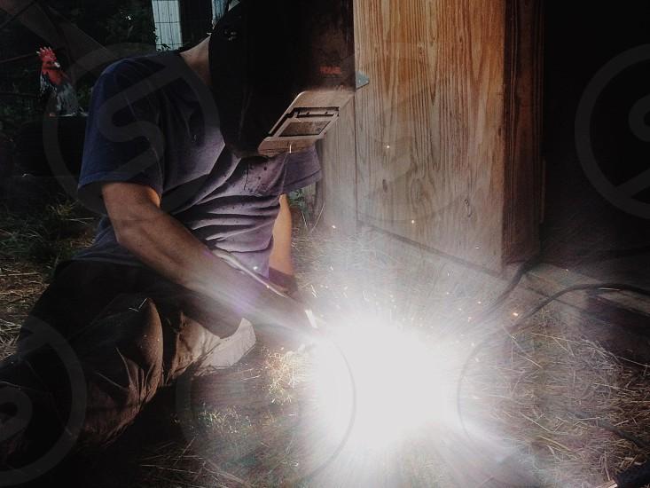 man wearing welding mask photo