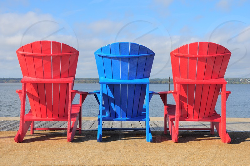 blue and 2 red wooden armchair photo