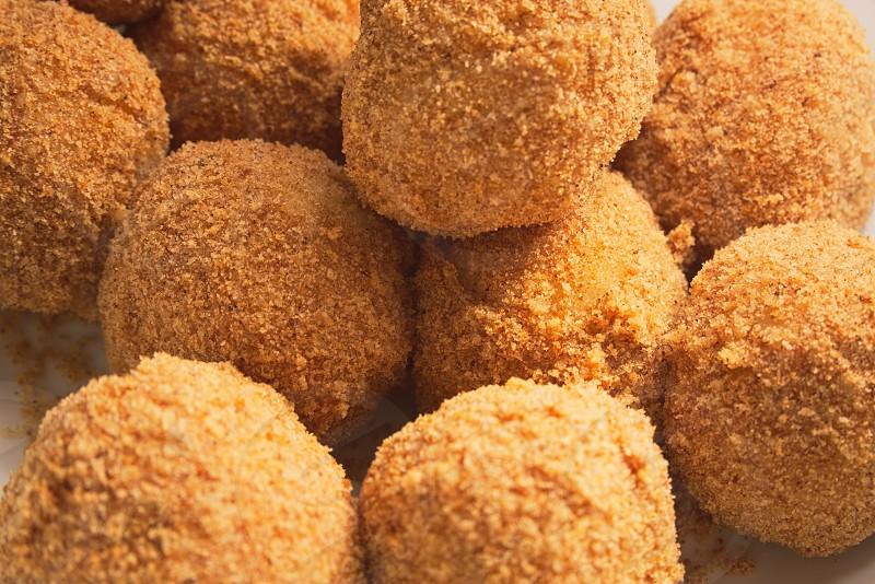 Plum Dumplings Covered in Bread Crumbs Closeup photo
