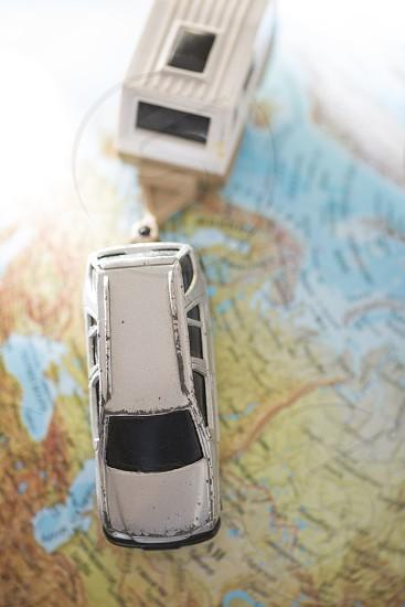 Car and caravan on globe. Miniature concept photo