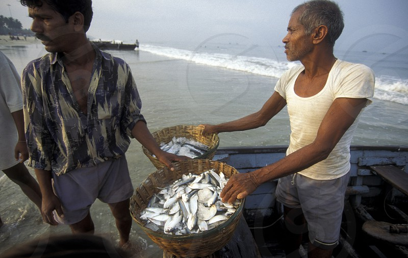Fishing men at the beach of Colva in the Province Goa in India. photo