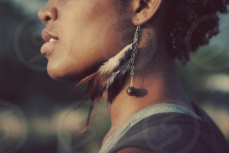 woman in black tank top and silver hook tribal earrings photo