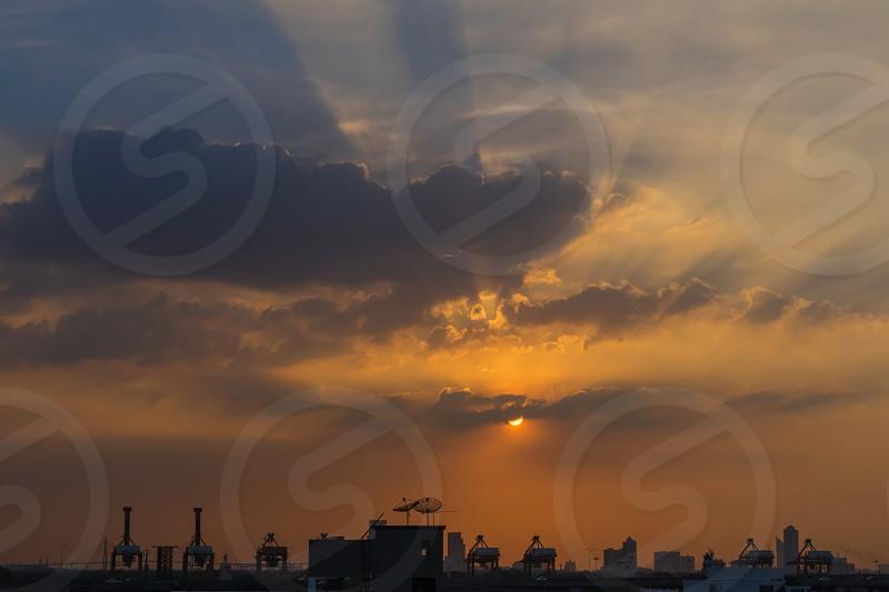 Sunset over Bangkok city with light rays. photo