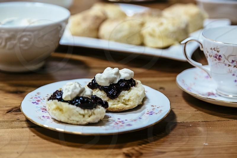 scones jam cream afternoon tea devonshire tea table serving teacup plate scone photo