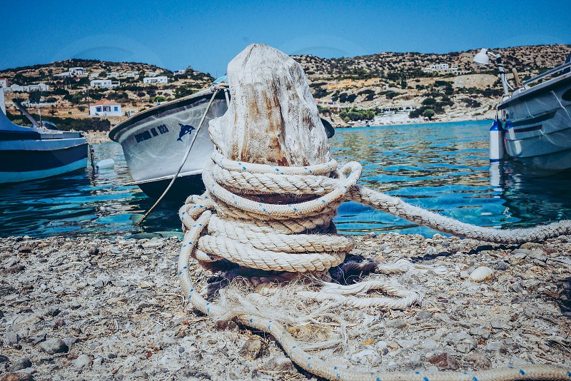 Boating lifestyle  boat tightened  sea water rope closeup harbor photo