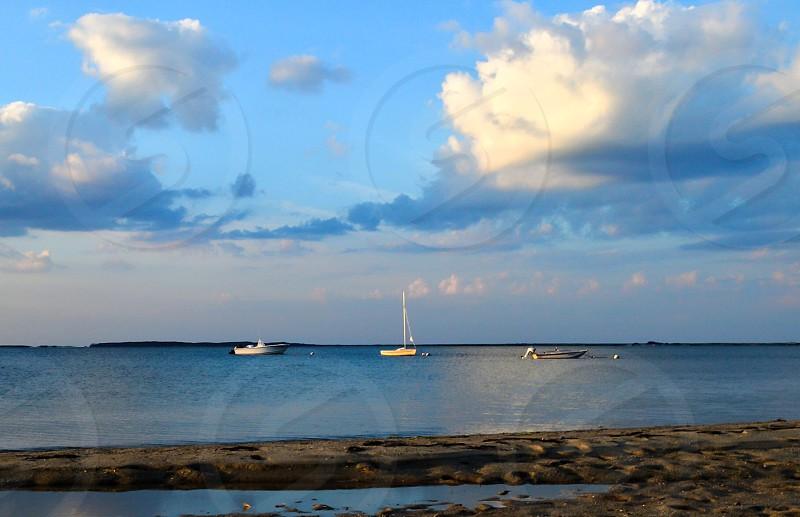 Boat sailing summer ocean evening sunset beach Nantucket photo