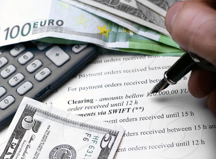 Homeformfinancetaxescalculatorbankinghandpenaccount photo