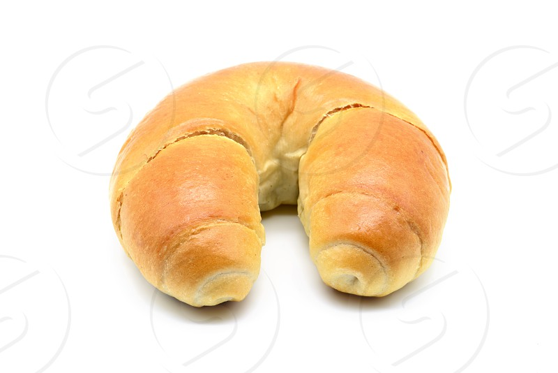 german butter croissant on white isolated background. photo