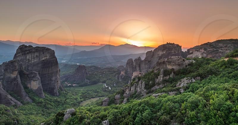 Panoramic sunset view of the Meteora  Monasteries near Kalambaka town in Greece photo