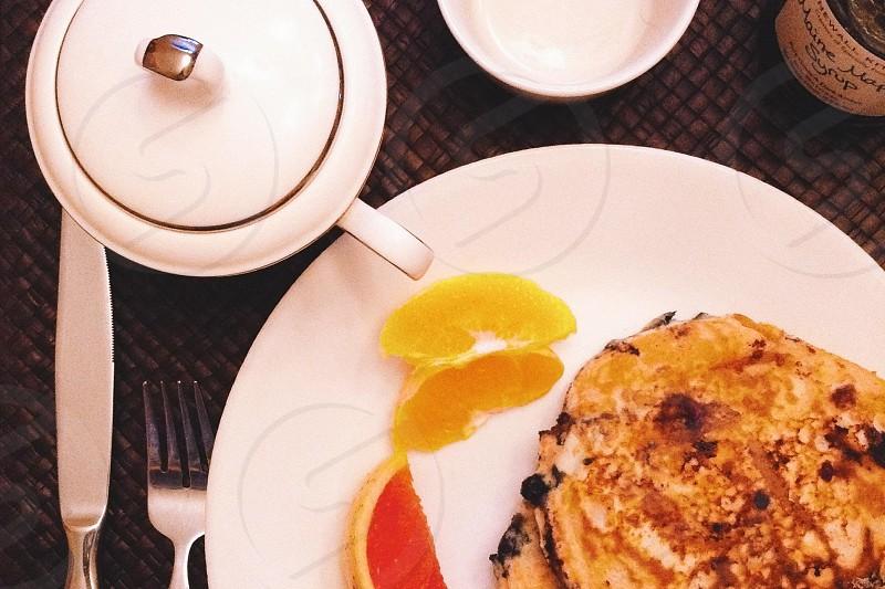 white plate beside fork photo