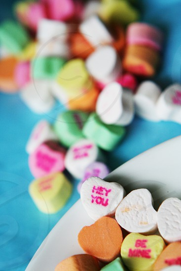 heart shaped marshmallows on white ceramic plate photo
