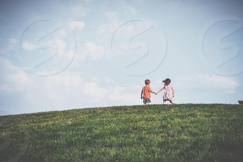 two children on mountain pick photo