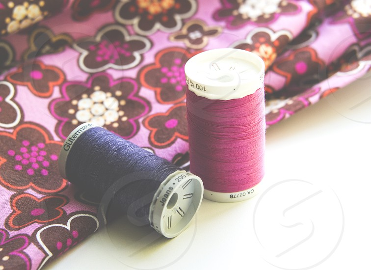 Fabric flower motives spools of colorful threads photo