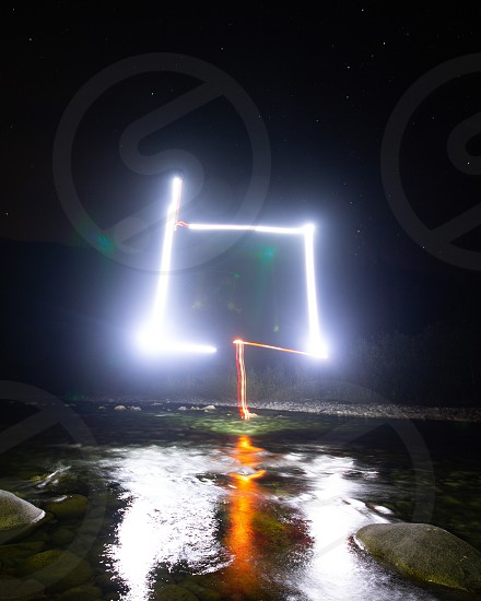 Night time long exposure of a drone fixed with LED lights.  photo