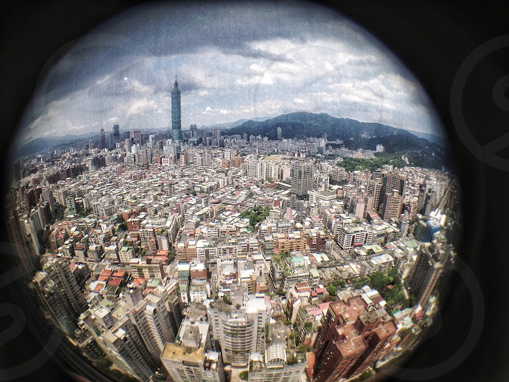 Lo-fi fisheye view over Taipei with the city tallest 101 building dominating the skyline. photo